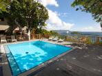 Shared pool and sun deck with views of St John