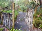 One of the paths through the garden - this one leading over a bridge to a plant lined winter stream.