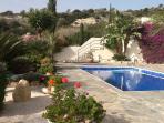 Pool and patio area, pissouri hillside behind