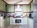Kitchen fully equipped and dining area at villa nilly amalficoast holiday accommodation booking rent