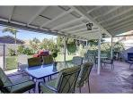 Two brand new patio dining tables with seating for 15. New BBQ. Large yard. Avocado and lime trees