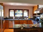 Updated Kitchen with Viking Stove and Sub Zero refrigerator.