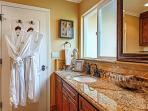 Spacious bathroom with granite counter.