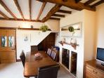 Dining Room with original beams & multifuel log burning stoves. Dining seating for 8