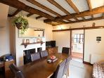 Dining Room with original beams & multifuel log burning stoves