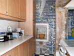 kitchen very well equiped for till 12/13 persons.Beautiful wall covered with XVIII century tiles.
