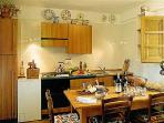 The compact kitchen has all you could want