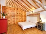 Pine clad bedroom with oak beams and pine floor