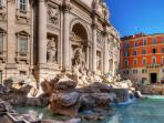 view of the Trevi fountain by the 2 windows of the living room
