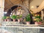 Mountain Inn lobby's old mill wheel. Good meeting place for having lunch or dinner together.