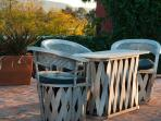 Faux equipales chairs on rooftop terrace