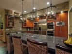 New modern Stone kitchen counters with large island. Nice entertaining area.