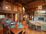 With the deck doors behind you, the dining room opens up to the upstairs living area and kitchen.