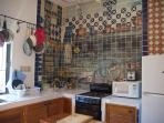 kitchen with cookware, cuisinart, blender, basic juicer, knives