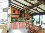 Rustic kitchen in the loggia with sink, cooker and side boards