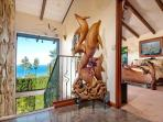 Big Sur sensibilities with hand-carved wood art and furniture.
