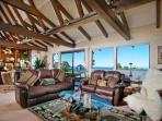 Great room has a wall of windows with a panoramic ocean views.