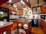 Spacious kitchen can accommodate more than one chef and helpers.