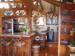 Kitchen has an eating bar.