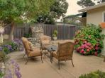 Beautifully landscaped yard surrounds you.