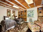 Guest Suite has a Beautiful Wood Interior and Skylights. It has 2 Twins that can also be a King with Memory foam Topper.