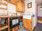 Full size oven, two ring induction hob, microwave, door to shower room, stairs to bedroom
