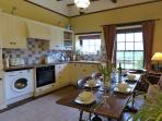 Fully equipped farmhouse kitchen with a large dining table for 6