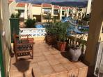 Seating area at front of house overlooking the pools