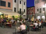 Dine out in one of the many piazzas in Barga