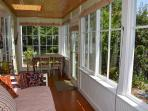 Porch with garden views, trundle bed and table