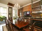 Mardi Gras Dinning Room has a grand dinning table and antique bar.