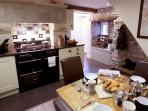 well equipped kitchen with extendable dining table