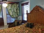 Cozy Guest Bedroom with big TV