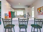 3 stools at the kitchen counter for quick meals and snacks. House has Central Air and Heating
