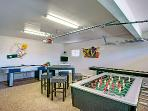 Game room has foosball, air hockey, shuffle board, and WII with plenty of games and a TV with dvd