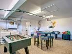 Game room with new ping pong table included! two commercial grade washers and 2 dryers provided!