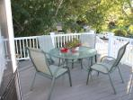 A beautiful deck with a light summer breeze all day.