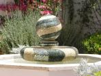 The hand-made mosaic fountain in the garden.