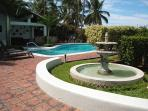 Fountain, pool terrace and cabana