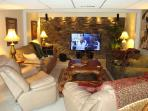 Media Room with 59 inch HDTV with surround sound & premium stations; DVD player & big movie library