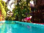 lap pool next to bungalow maria