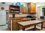 Large spacious kitchen with pantry, full size fridge, stove & microwave.