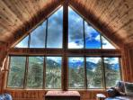 Floor to ceiling windows provide views of Rocky Mountain National Park and the Continental Divide