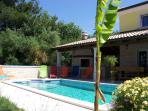 Outdoor view with the private swimming pool and the BBQ