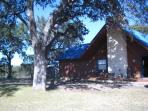 The cabin sits on 1.5 acres surrounded by stately old oak trees.