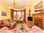 Lounge, sofas seat 5, views to Calton Hill & Arthur's Seat