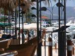 Latchi - enjoy a sun-downer before dinner in one of the lovely bars lining the harbour