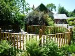 Decking in private enclosed garden  with picnic table