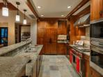 Chefs kitchen includes granite counters, Wolf oven, Sub Zero refrigerator + more