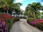 Drive through the gated entrance and enter a tropical paradise